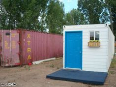 An excellent article about a $8000 house prototype out of a standard shipping container that hauls goods worldwide — a 320-square-foot home with a kitchen, bath with toilet, sleeping areas, windows and a bright blue door. The exterior is painted with a white epoxy coating that has light-reflecting properties to prevent the sun's heat from penetrating.      Each small house includes hookups for air conditioning, ventilation, electrical and water systems, and the units ideally could be set up…