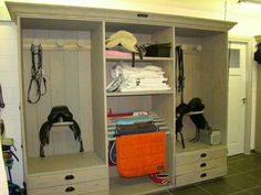 Entertainment cabinet turned organized tack room. Brilliant idea!