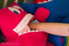 pajama eater pillow monster-put pjs in in the morn so they are easy to find at nite!