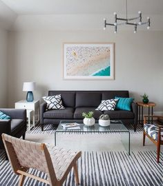 If you set a subtle, simple color palette, you can have a room with furniture that focuses on contemporary comfort but also mixes in a rustic live-edge table detail and a surprisingly modern acrylic table.