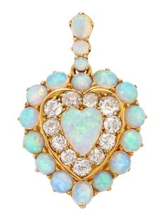 A lovely, lovely Victorian opal and diamond pendant in gold.  ~ Diamonds in the Library