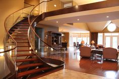 WOW! What a great first impression of this home when you walk through the front entrance. Beautiful Brazilian Cherry stairway, with curved Starlight glass balustrade. Wood Floor Stairs, House Stairs, Curved Staircase, Staircase Design, Grand Staircase, Bungalow, Big Living Rooms, Glass Balustrade, Glass Railing