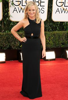 Amy Poehler in Stella McCartney. The partial halter neck, cutout, and patent-leather belt add excitement to the formal silhouette.  See more black dresses.