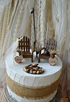hunting-camping-fishing-outdoors-wedding-cake topper-fishing groom-lake house-themed-wood chairs-bride and groom-camp fire-fishing pole