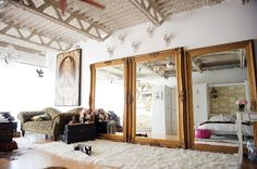 An oversize mirror rested against your wall creates the ultimate, laid-back yet luxe look. While you don't need a set of three, the bigger the mirror, the better for this styling trick. Source: Hong Photography Studio via Style Me Pretty