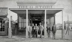 This drug store, circa 1877, operated in Dodge City, Kansas on the northwest corner of 2nd and Front Street. The man on the right is Dr. Thomas L. McCarty Dodge City's first doctor.