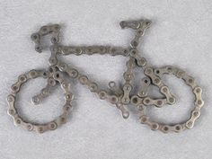 This is a bicycle made from repurposed bicycle chain. Each link is welded together on the back side to keep the shape.    Excellent gift for