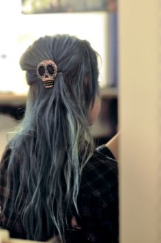 mexican sugar skull hair clip in lovely dirty/faded blue dyed hair.
