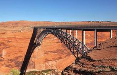 This steel-arch bridge, balancing across the rust-red Glen Canyon, is an impressive feat to behold. Arch Bridge, Pedestrian Bridge, Rickety Bridge, Glen Canyon Dam, Chesapeake Bay Bridge, Railroad Bridge, Lake Powell, U.s. States, Top Destinations