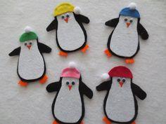 Quality felt. Handmade. 8cm tall. White felt is stiff type with sparkles.    Five little penguins    Five little penguins swam the ocean floor,