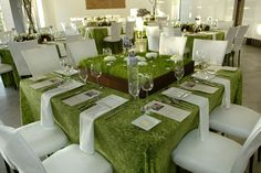 Grass centerpiece scattered with flowers to mimic a field