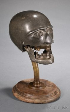 Cast iron dental articulator skull, 19th century (1800s). These were used as medical training tools for dentists.