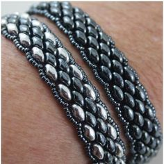 Seed bead jewelry Super Duo bracelets in Hematite and Silver using Kelly Dale's Youtube video. She makes a triple wrap, these are singles. Discovred by