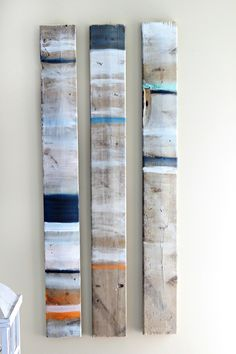 Take an some old pallet wood, paint a few random stripes and hang. FREE coastal wall art.