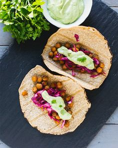 On a busy weeknight, taco recipes to the rescue! These spiced chickpea tacos are vegetarian and vegan, and featuring an avocado cream drizzle.