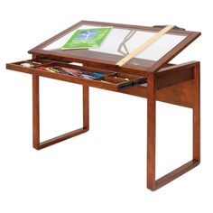 Love this art desk! You can see all the art supplies in the drawer when it's closed, and I bet you could rig that up to become a light table for quick tracing/redrawing.