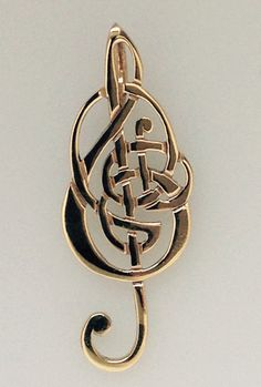 Celtic treble clef available in Gold or Silver as a brooch or pendant