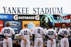 Joe Girardi, Brett Gardner, Derek Jeter, Jacoby Ellsbury and Brian McCann remove their caps for the National Anthem.