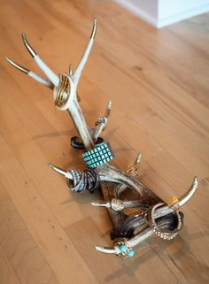 Re-purpose antlers to create a great jewelry display. Thanks to my fiance and his great deer slaying skills. =)