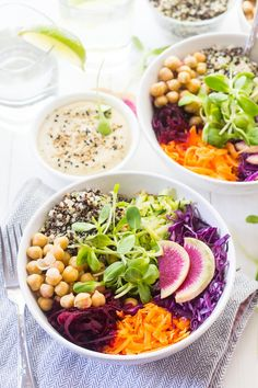 This Shredded Summer Salad is filled with nutritious, raw veggies and topped with a rich and tasty garlic tahini dressing!