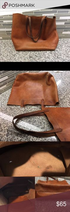 Madewell cognac Leather Transport tote Used condition with life left. Interior does have a few minor pen marks. And outside has normal wear from use. Please see photos as this has been used! NO TRADES AND PRICE FIRM. Madewell Bags Totes