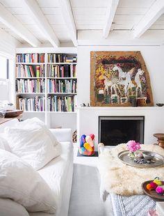Living room   Photo by Brittany Ambridge via Domino