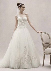 Enchanting and elegant, this one shoulder ball gown is the epitome of sheer romance.   Sweetheart neckline is accented with on-trend embellished one shoulder detail.   Ornate beaded lace appliques adorn the bodice and skirt to add eye-catching appeal.  Tulle ball gown skirt gives this style volume and drama.  Chapel train. Available in stores and online in Ivory. Available for special order in stores in White.  Petite: Style 7CKP421. Sizes 0P16P.,100 (special order only). Woman: Style 8CKP421...