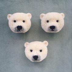 Tsubasa Kuroda creates realistic-looking animal brooches that resemble pom poms.