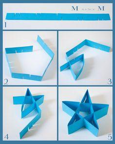 M double M: Folded paper stars (DIY). - http://www.mdoublemcrafts.com/2012/06/folded-paper-stars-diy.html