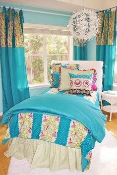 love all the bright colors with pops of white in this girl's room