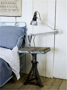 Make an industrial side table out of an old jack.