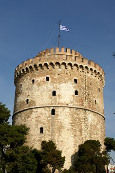Photo about White Tower and the greek flag, Thessaloniki, Greece. Image of tower, ancient, tree - 1640837 Greece Thessaloniki, Greek Flag, Sketchbook Ideas, Digital Illustration, Louvre, Tower, Cartoon, Wallpaper, Travel
