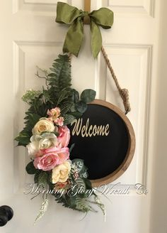 Beautiful Welcome chalkboard sign with artificial florals. #morningglorywreathco #chalkboard #welcome #doorhanger #floraldisplay