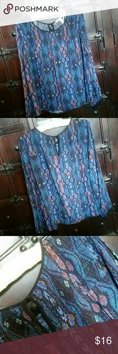 """F21 Smocked Aztec Blouse with Keyhole Back Forever 21 Contemporary blouse. Long sleeve with black banding at wrists & black piping around neckline and keyhole back. Puckered smocking in front and back of blouse. In good shape, EUC. Colors are navy, purple-blue, green, orange, & black. It is gorgeous! Bust: 24"""" Length: 23.75"""" Shoulder: 16.50"""" Forever 21 Tops Blouses"""