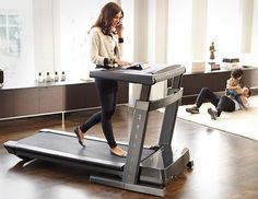 Forget standing desk, what about a walking treadmill desk like the Thinline Pro Desk Treadmill?
