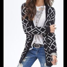 Forever 21 Fuzzy Oversized Diamond Sweater NWT S This super cute black fuzzy oversized diamond Forever 21 sweater is perfect to cozy up in for the upcoming fall months.  New With Tags, size Small (also fits M) Forever 21 Sweaters