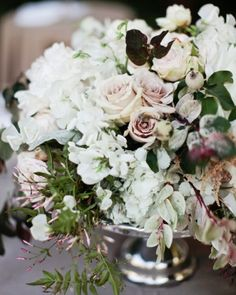 A bunch featuring jasmine, hydrangea, garden roses, and sweet peas