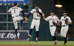LEAP OF JOY:    Carlos Correa (1) of the Houston Astros celebrates with George Springer (4) along with Josh Reddick (22) and Jake Marisnick (6) after the final out against the Los Angeles Angels of Anaheim on April 20 in Houston.