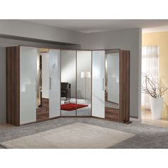 Are you searching #wardrobes with wider and deeper options? Here your search ends, buy Gastineau wardrobe in French walnut and white# gloss to meet your #storage demands efficiently.