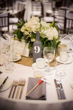 wine bottle table numbers // photo by Jaylena Photography