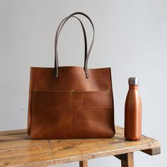 Handmade Leather Computer Tote with pockets.jpeg