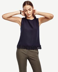 Made from refined matte jersey, this new arrival is edged with a pretty lace hem for a bit of wear-now wow. Jewel neck. Sleeveless. Back yoke with knife pleats. Hidden back zipper with hook-and-eye closure. Top applied lace hem.