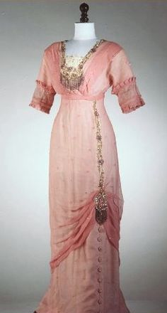 1918-1920 soft pink dress with lovely detailing. Looks earlier to me - hobble skirt, empire waistline, embellishments...