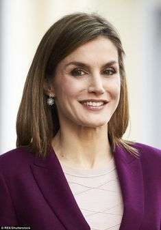 With a slick of purple lipstick and pretty silver drop earrings, Letizia looked happy and ...