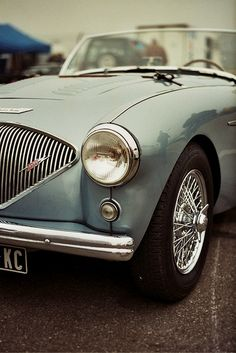 Austin Healey - British sports cars...love them. Tooled around in one of these with first love!