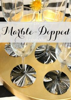 DIY Marble-Dipped Stemware, perfect for a New Year's Eve cocktail party! Cheers to the New Year! #evitegatherings
