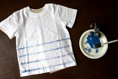 She used a toy car to make tracks on this shirt - fun!!  - Fabric Painted Boys T-shirt Inspiration