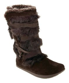 Comfort's guaranteed with this winning suede boot. Faux fur lining cradles feet in serious softness, while a patented ''negative heel'' shifts weight for healthy steps. Adding to the appeal is rabbit fur trim on the exterior for a luxurious finish.