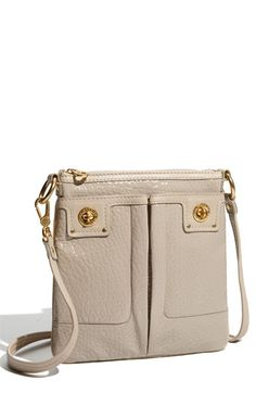 marc by marc jacobs...'totally turnlock-Sia'. my new purse that my mom bought for me :D