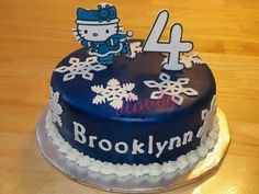 Hello Kitty Winter Wonderland.  Fondant cake with 2D character cut outs.